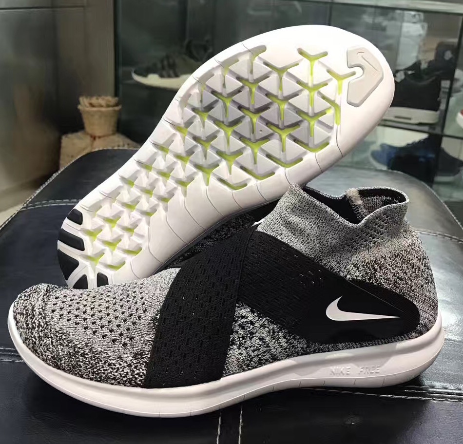 nike free run motion flyknit oreo